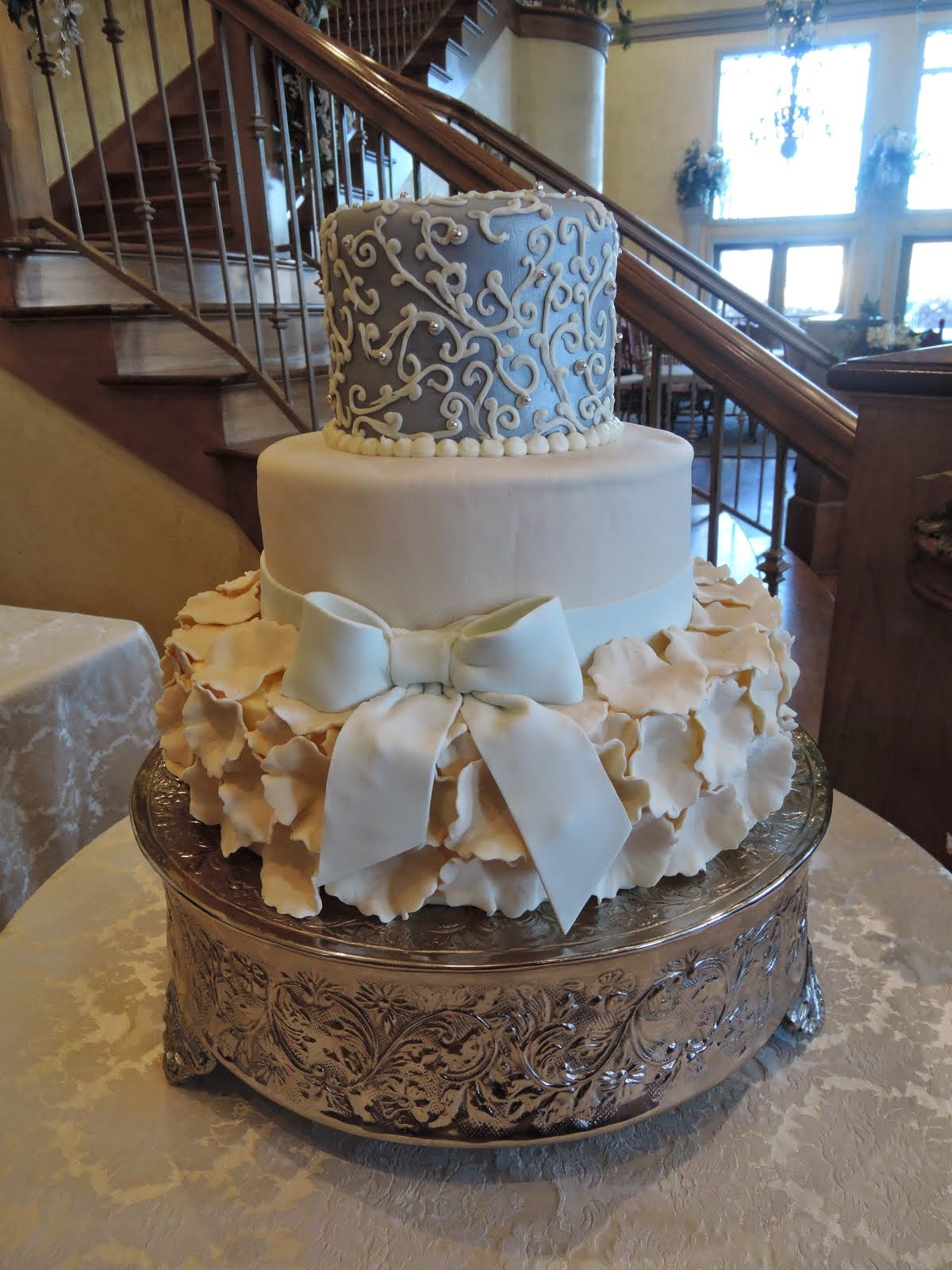 3-tier round fondant petals and bow