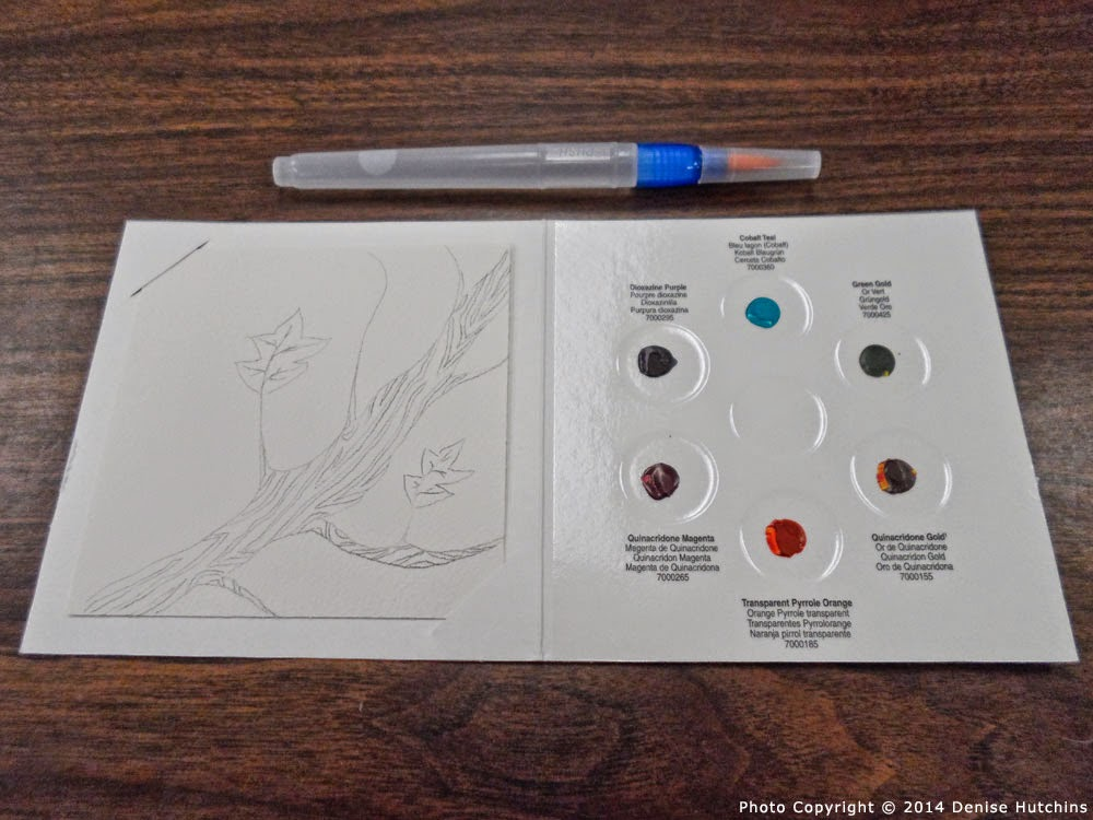 Watercolor Sample Palette with Sketch on Paper and Water Brush