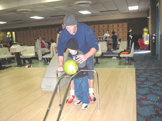 7-year-old Dalton bowling with his dad