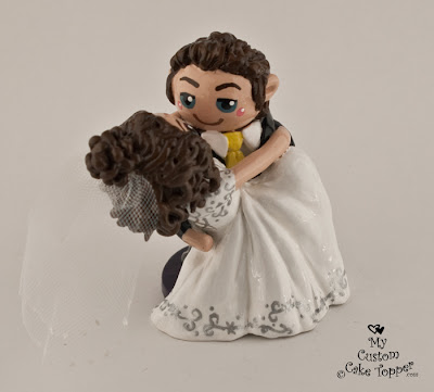 groom sweeping bride off her feet wedding cake topper