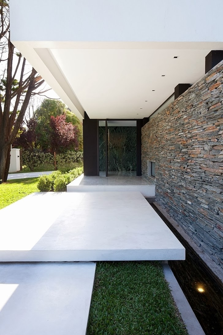 Entrance facade in Minimalist Casa Carrara by Andres Remy Architects