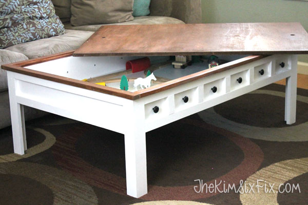 a train table and tons of extra storage. (Even if you didn't have kids, it  would be a great place to hide a blanket or your laptop or magazines or  whatever ... - Apothecary Style Coffee Table With Hidden LEGO And Train Play