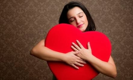 Importance of Self-Compassion  - woman girl hug hugging heart big tedy red carry hold