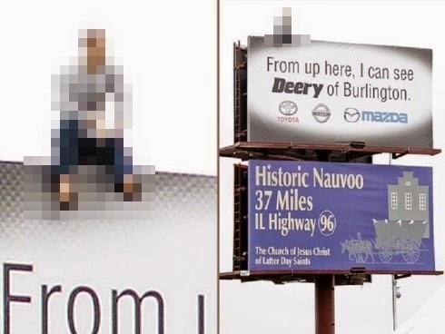Lelaki duduk di atas papan tanda iklan undang cemas pengguna lebuh raya kerana menyangka ia hendak membunuh diri