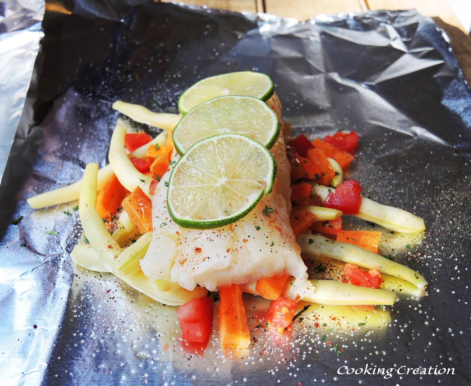 Cooking creation grilled zesty haddock vegetable foil for Grill fish in foil