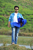 Ram Charan Rocking Photos from Racha Telugu Movie-thumbnail-5