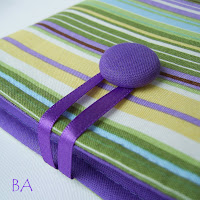 Handmade fabric Kindle sleeve in purple, green and yellow stripes.