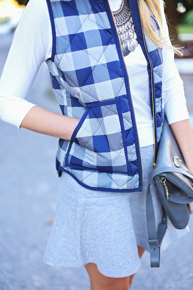 wearing the plaid puffer vest