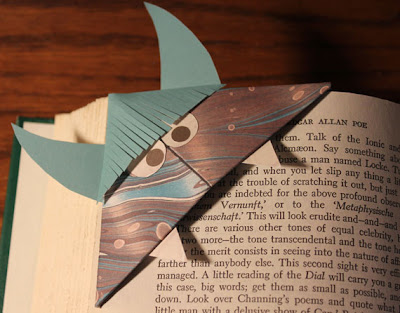 origami monster bookmark on an Edgar Allan Poe book