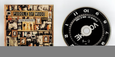 Puddle_Of_Mudd-Life_On_Display-(UK_Import)-2003-DeBT_iNT