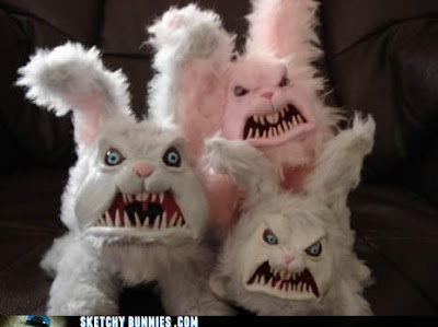 Three angry bunny costumes with sharp teeth