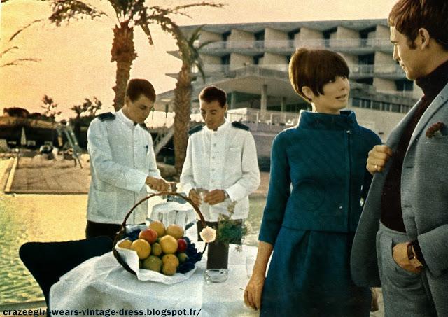 """1960 1966 60s 60's 1960's fashion pierre cardin andre courreges sixties années 60 space age mode Du désert du Neguev à Saint~Jean~d'Acre, de la Mer Morte à Tel-Aviv, Paris, le mois dernier, était à l'honneur : Pierre Cardin présentait sa collection aux Israéliens. Première étape ; le musée d'Israël à Jérusalem où, sous la présidence de Mme Eshkol, femme du Premier Ministre, les """" cosmonettes """" ont défilé devant le dôme étincelant du """" Sanctuaire du Livre """", Fêté par tout , le grand couturier a découvert ce tout jeune pays vieux de 4000 ans avec autant d'enthousiasme que celui-ci mit à l'accueillir.   A vous de les applaudir tous deux dans les pages qui suivent .Dans ce pays ultra-moderne, on rencontre à chaque pas , les témoins d'un riche passé. A Jaffa , un des plus vieux ports du monde, la boîte de nuit à la mode - Le """"Hammam"""" - s'ouvre sur un antique portique .     Ci-dessous ,  une chasuble """" cosmocorps"""" en lainage, avec un pull-over à col roulé .A Césarée , un acqueduc romain longe la plage , joyau de la """"Côte d'Azur"""" israelienne .     Ci dessous  , cosmocorps à carreaux .Et, au fin fond du désert du Neguev , surgissent les légendaires mines du roi Salomon dont on extrait encore le cuivre .  Ci dessous , deux cosmocorps en lainage Le somptueux hotel du Golf , construit par le baron Edmond de Rothschild dans ce grand centre de villégiature qu'est Césarée.  Tailleur en lainage capitonné , jupe froncée , veste à col officier.Ci dessous , ensemble en lainage à carreaux ton sur ton .Partout en Israël se croisent l'Orient et l'Occident . En Galilée , dans la vieille ville de Nazareth , un souk oriental aux éventaires pittoresques .  Manteau blanc en lainage , évasé dans le bas , et manteau vert en gabardine , fermé par une broche dorée .and now my Cosmocorps ."""