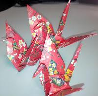 three origami cranes