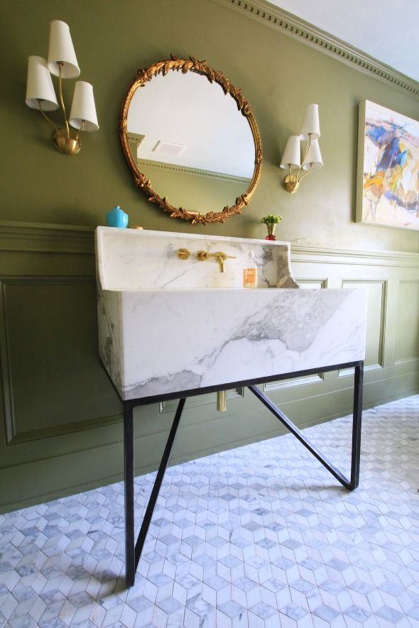 Marble farmhouse sink with brass accents