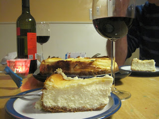Cheesecake, sliced, and glass of wine