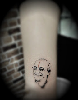 portrait tattoo on the leg
