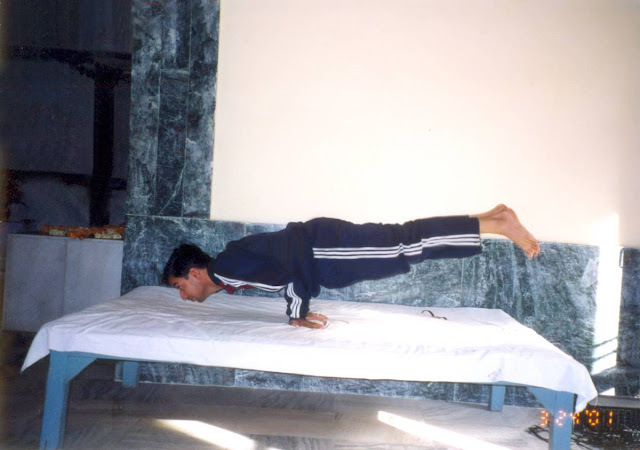 Yoga master Rajendra Pandey Demonstrating Mayur Asana at Yog Niketan Rishikesh