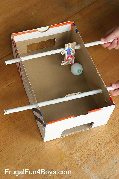 http://frugalfun4boys.com/2014/06/29/make-shoebox-foosball-game/
