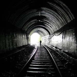 Crossing the dark tunnel