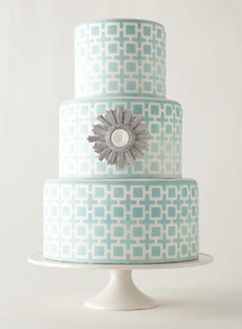 Aqua wedding cake with starburst mirror