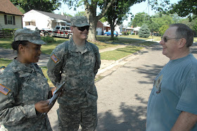 Sgt. Jessica Cooper (left) and Pvt. Jason Geier, of Headquarters and Headquarters Company, 216th Engineer Battalion, talk with John Weese, 60, of Columbus, Ohio, on July 2, 2012. (Ohio National Guard photo by Senior Airman Jordyn Sadowski)