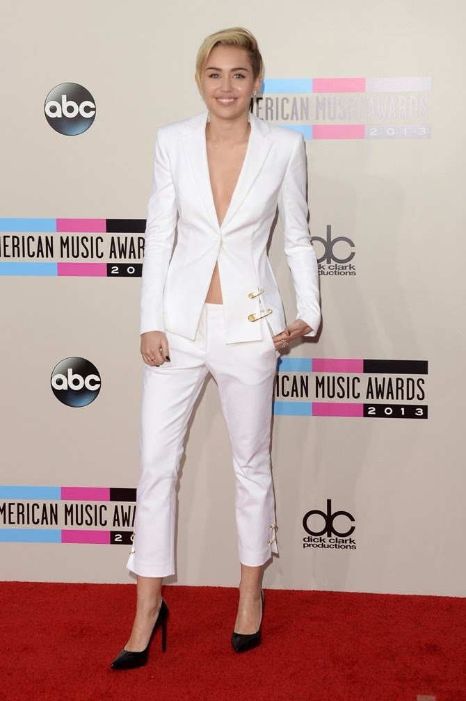 Miley Cyrus, who stuck to her favourite monochrome look for the red carpet