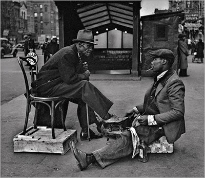 http://kvetchlandia.tumblr.com/post/101235219363/john-gutmann-shoeshine-harlem-new-york