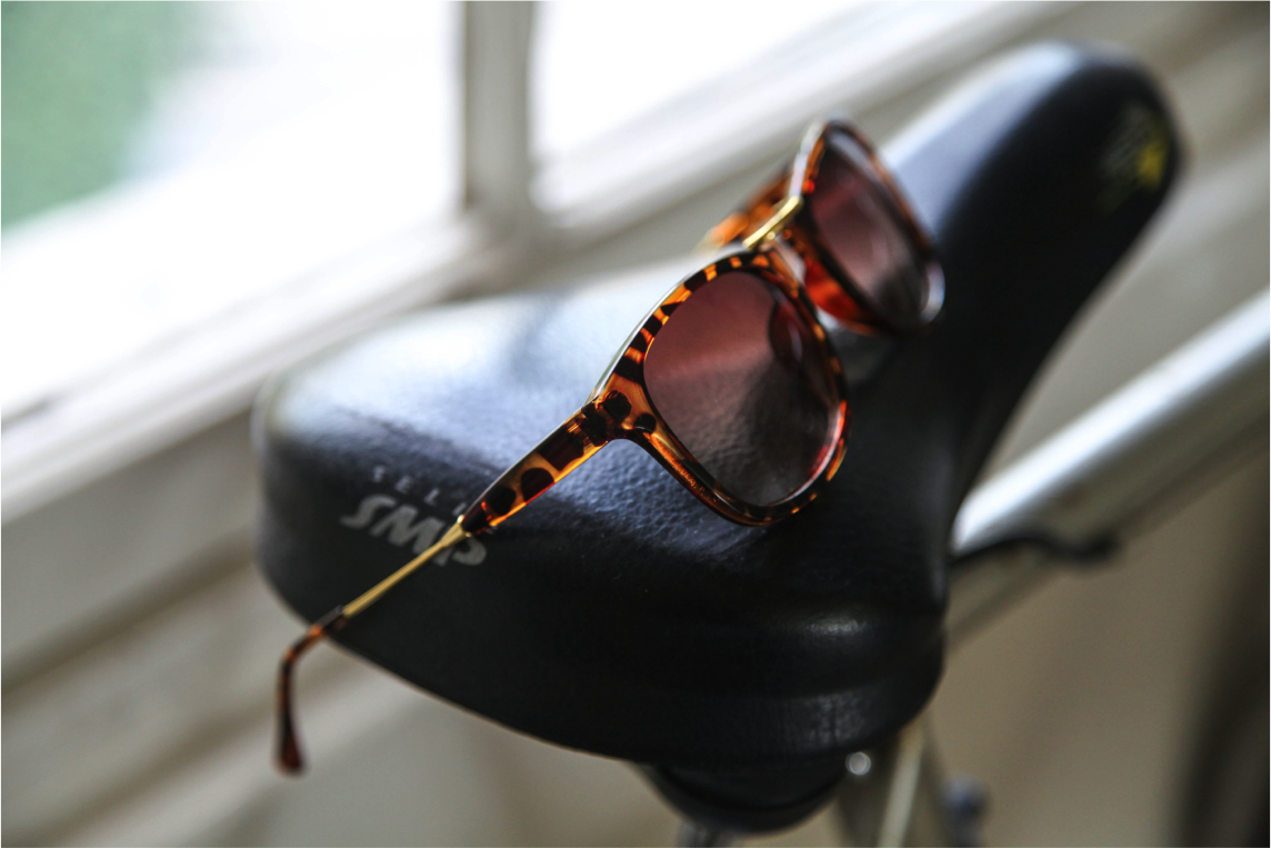 firmoo free sunglasses in tortoise frame on bicycle fashion photography