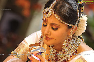 An Indian bride just married in midst of gold jewels.