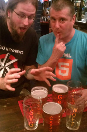 Beers with non-HTML5 technologies imprinted on them. And Bruce Lawson and Chris Mills looking horrified and sheepish, respectively