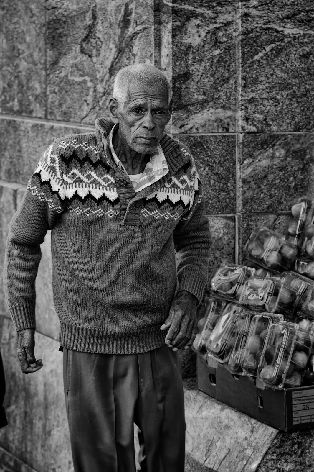 A portrait of a fuit seller in Cape Town