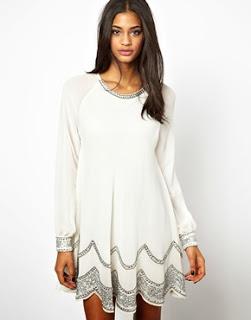 Vestido de fiesta blanco con detalles en plata. Vestido para noche vieja