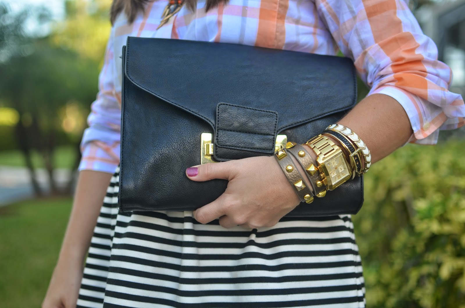 Stripe skirt - check shirt - black clutch - chunk heels - Emma & Sophia - statement jewelry
