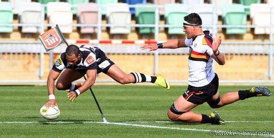 Ryan Tongia, Hawke's Bay Magpies, scores a try - Pre-season rugby vs Waikato. Magpies won 39-22 photograph