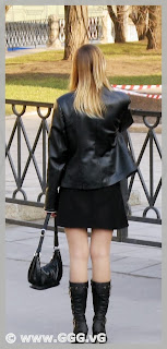 Girl in leather jacket on the street