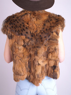 Vintage 1970's brown lapin fur vest with scalloped hemline and hidden front closure.