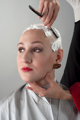 woman getting her head shaved bald