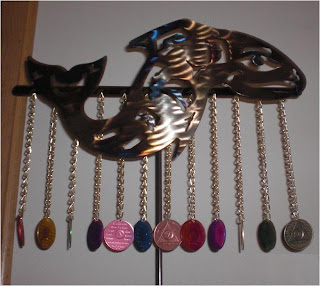 spiritual fish symbol with sobriety chips hanging from chains