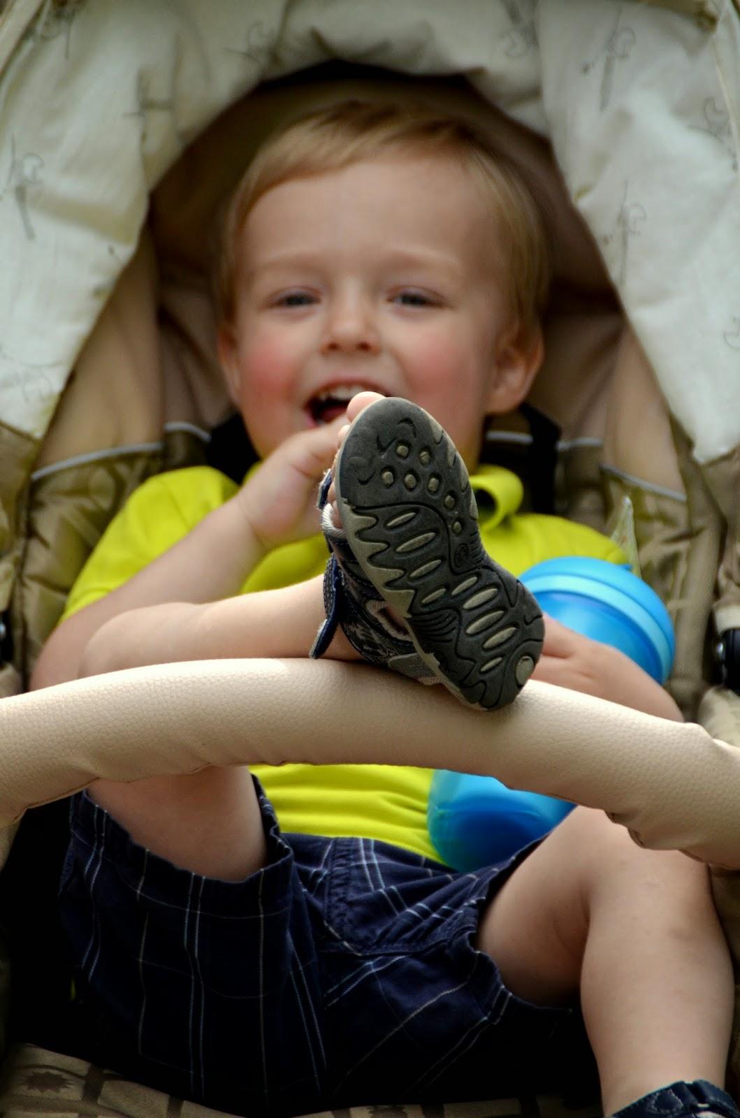 toddler in stroller sandals