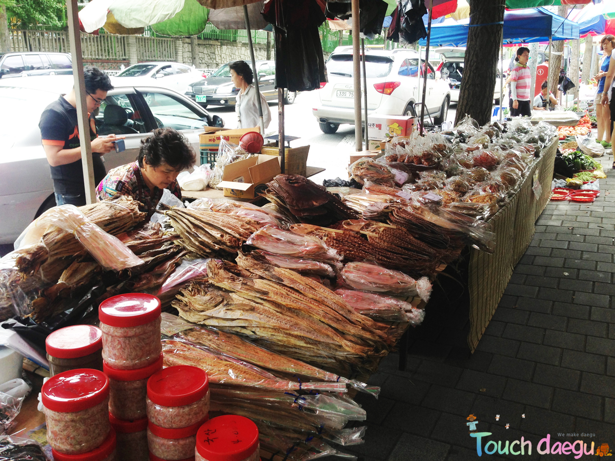 A vendor who sells dried fish and seafood