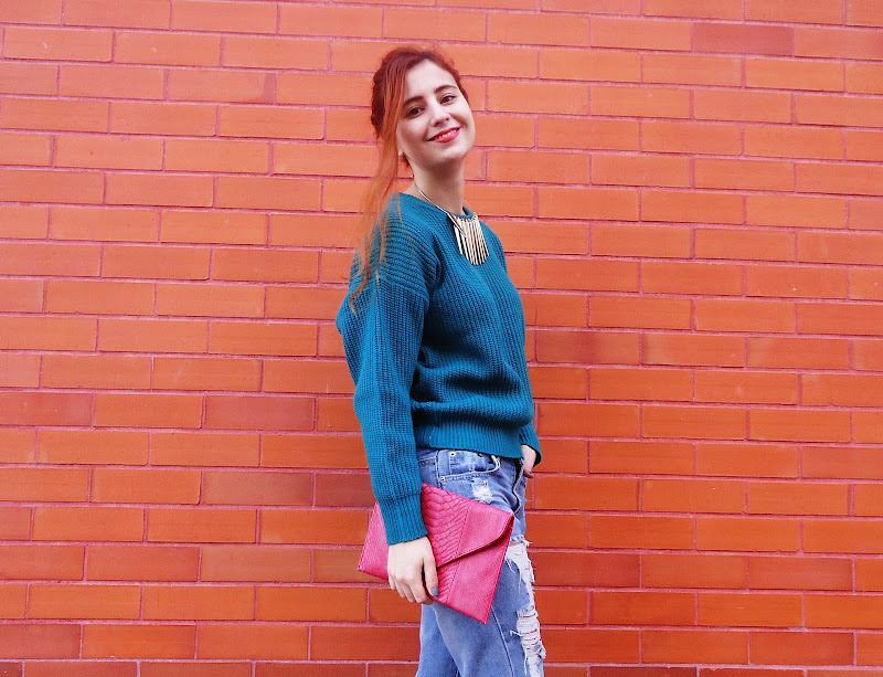 blogger smiling wearing green jumper