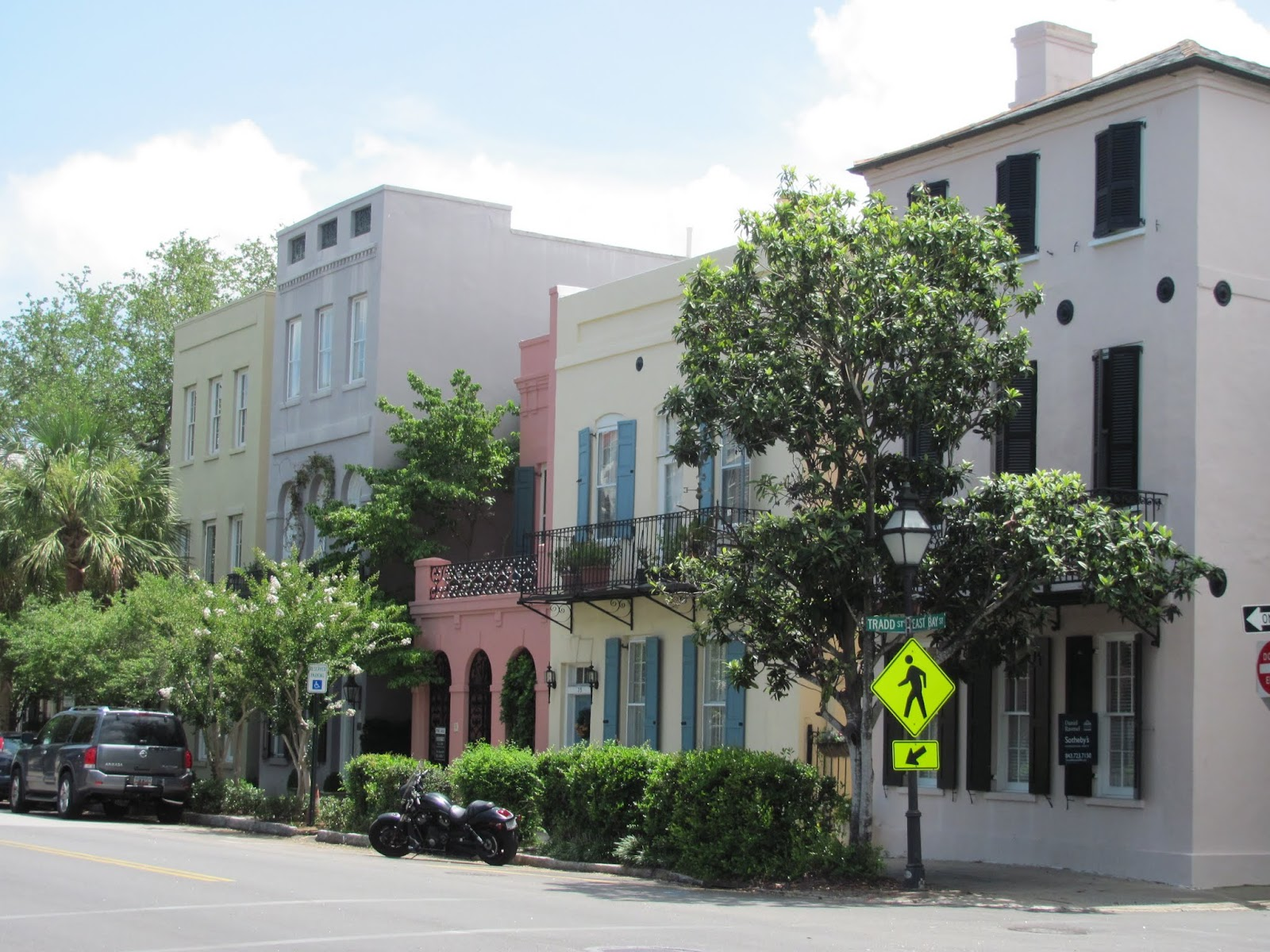 Pink, yellow, and tan homes on Rainbow Row in Charleston, SC