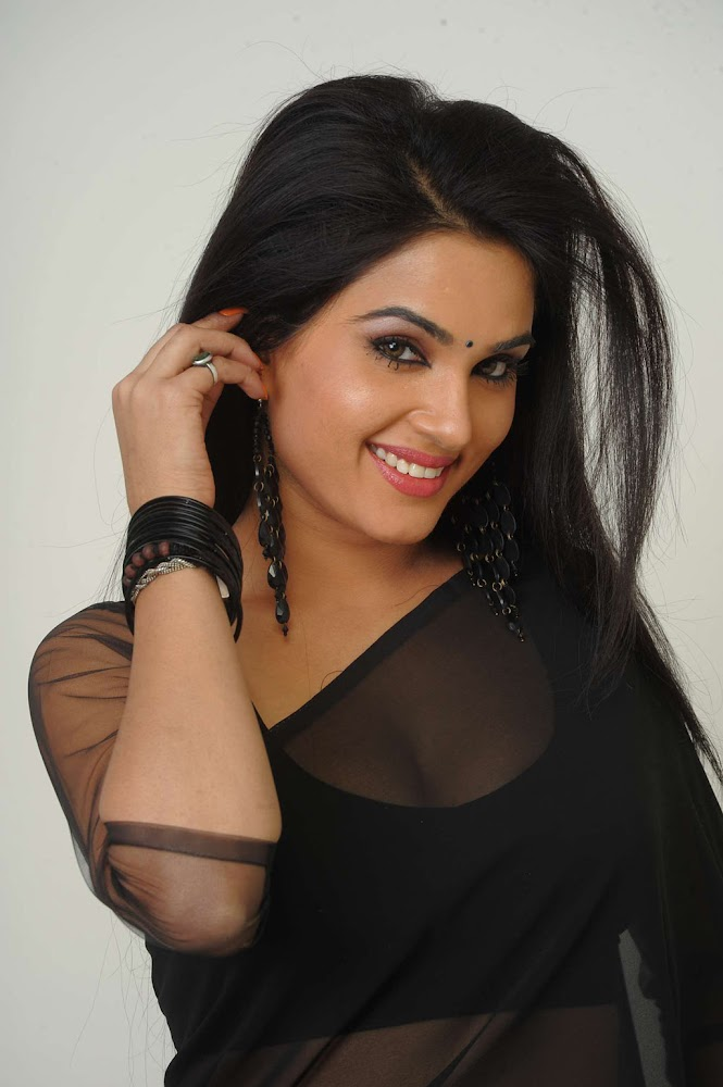 Actress Kavya Singh Sexy And Hot HD Images  In Black Transparent Saree Showing big And Deep Cleavage