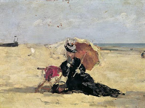 Woman with a parasol on the beach