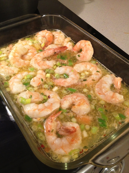 Shrimp scampi in a glass baking dish, right out of the oven