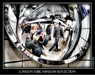 self portrait in curved mirror in the London tube