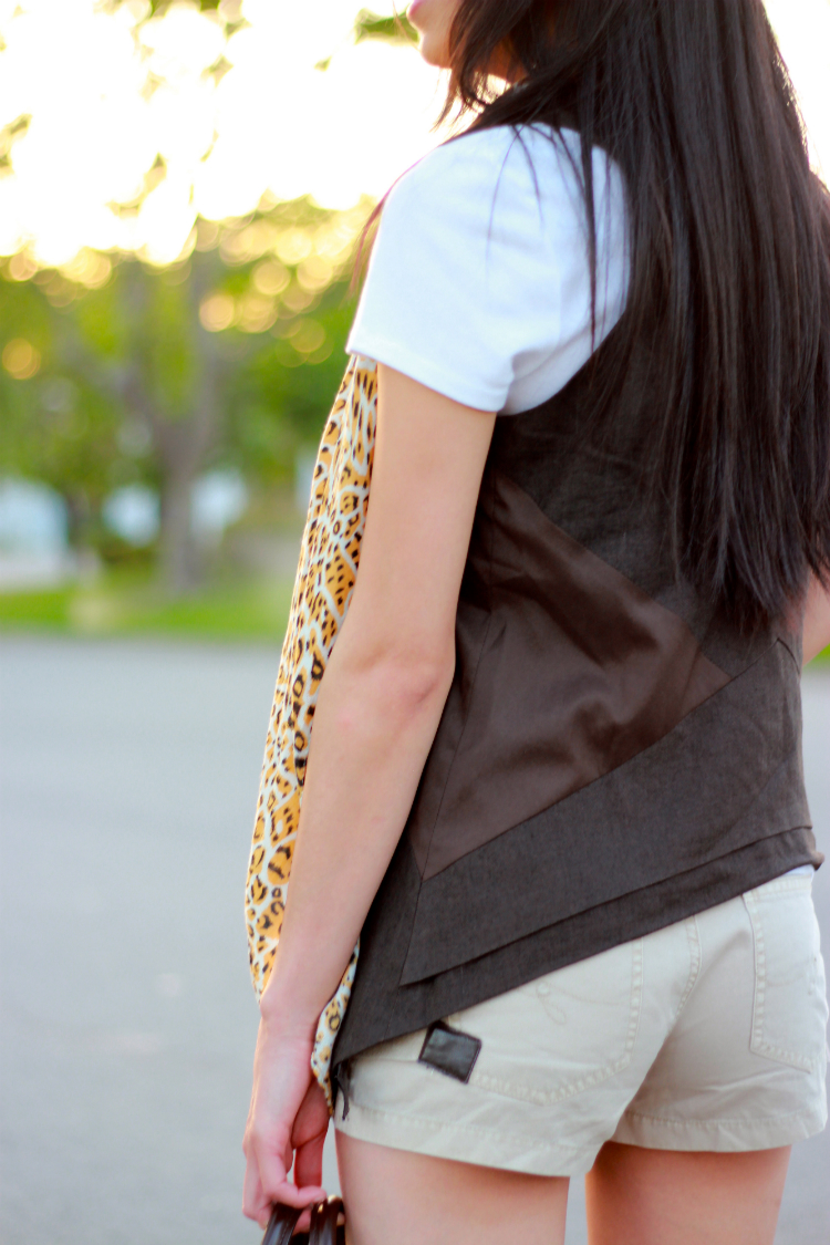 skort khaki tshirt light leopard scarf gladiator sandals layering vest louis vuitton speedy