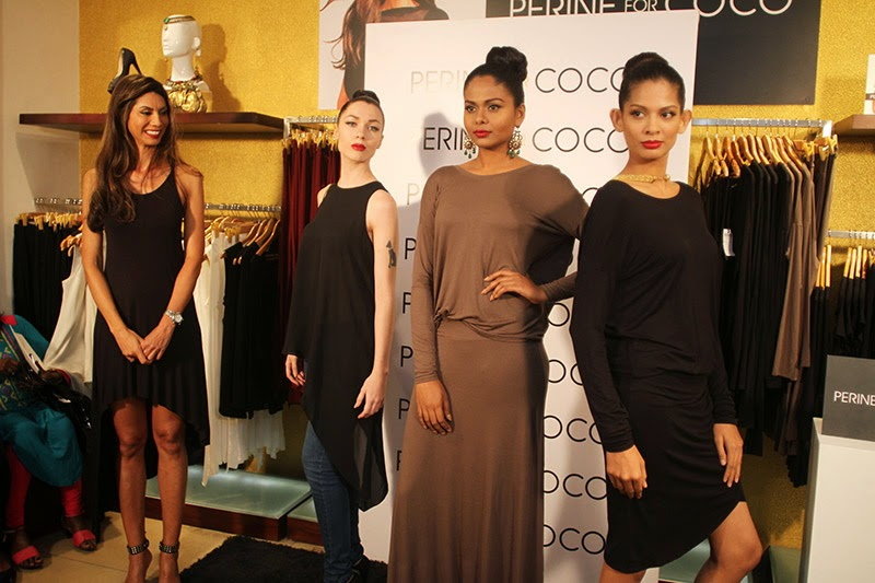 Models wearing Perine for Coco AW2014 Ready to Wear Collection, as Perine Fernando looks on