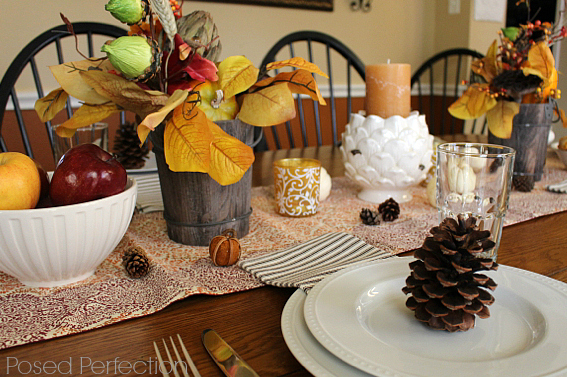 Golden Autumn Tablescape with pinecones at place settings