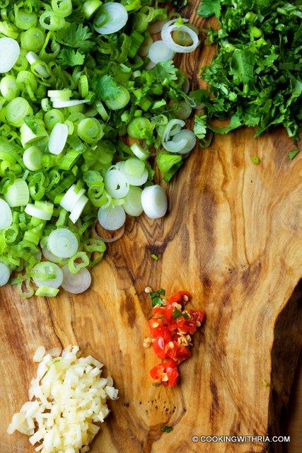medium high heat in a wide heavy bottomed pot. Add scallion, cilantro ...